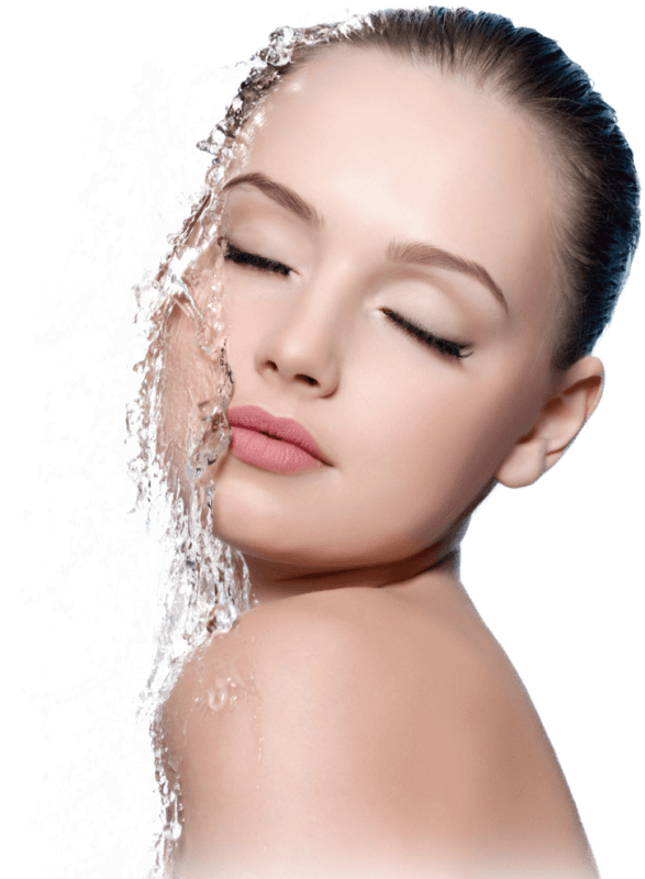 Young women with water splashing on face