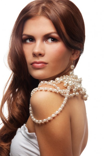 Good looking young woman with pearls necklace